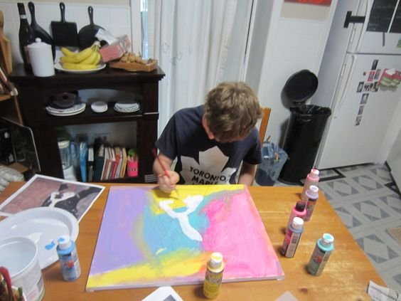 Ten year old boy paints a Boston terrier